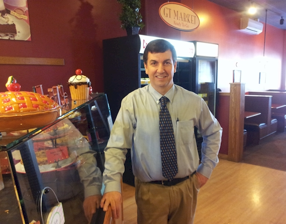 Petoskey GT Pie Co. owner Scott Byrd in his shop on Pi Day, wearing the tie to honor his former math teacher.